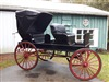 Elmira Carriage Co. 2-Seater horse carriage with top, c. 1900.  single & team shafts included.  Fully restored.  Custom upholstery.  Rubber wheels.  M